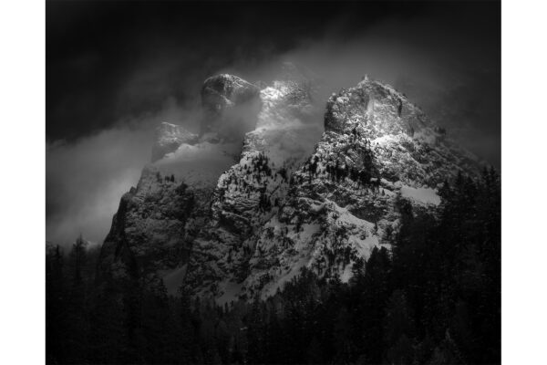 Black and white photograph of three peaks in the Italian Dolomites